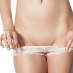 woman undressing her panties and shows her waxed pubic area